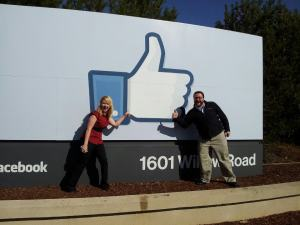 "Altimeter Group's Jaimy Szymanski and Zak Kirchner, really ""liking"" Facebook's sign."